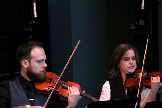 Violinists Joshua Modney and Olivia De Prato of the Mivos Quartet perform in the BAMcafé on the second day of the 2013 Crossing Brooklyn Ferry festival.