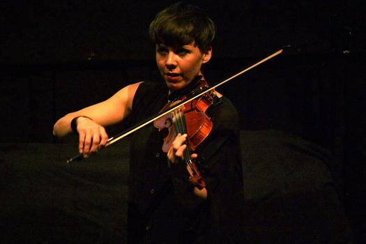 Violinist Sarah Neufeld, a member of Arcade Fire, performs solo in the BAM Rose Cinemas on the first day of the 2013 Crossing Brooklyn Ferry festival.
