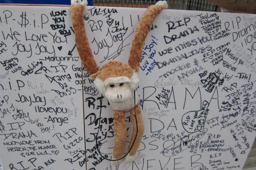 A monkey left on the memorial represents Jorge's sillier side.