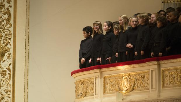 The Chicago Children's Choir, in the balcony, led by artistic director Josephine Lee.
