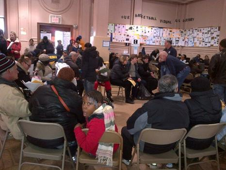 Residents seeking assistance sit and wait their turn at the Coney Island Restoration Center