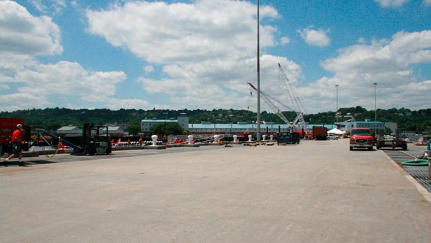 A view from the pier depicts six barges upon which nearly 40,000 firework shells have already been packaged.