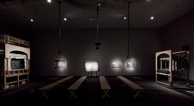 "Installation view of ""Black Box/Chambre Noire,"" ""Learning the Flute,"" and ""Preparing the Flute"" (L to R). Art by William Kentridge. Music by Philip Miller. 2005, 2003, and 2005."