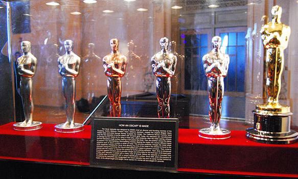One of the displays also includes the statuettes in various stages of completion, as manufactured by R.S. Owens & Company in Chicago.