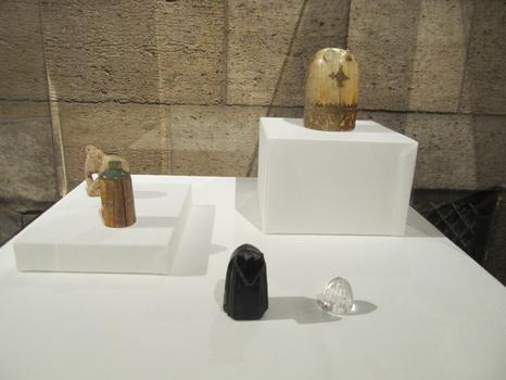 Earlier chess pieces accompany the Lewis chessmen exhibit include an elephant.