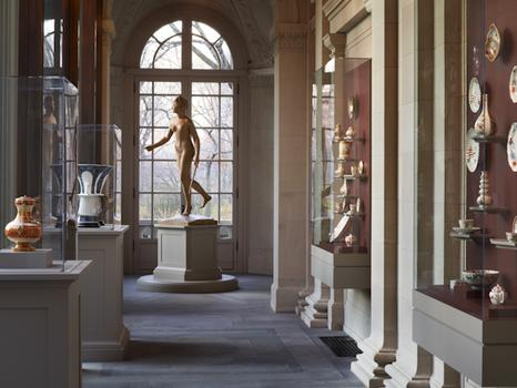 A view of the Portico Gallery, taken inside, shows Jean-Antoine Houdon's sculpture Diana the Huntress at the far end of the gallery.