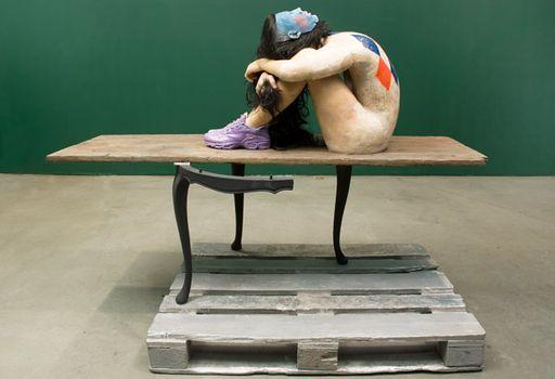 Sneakers 1, 2008. Wax figure, aluminum casted table and palett, Akrystal board, and ceramic shoes, 59 x 72 7/8 x 39 3/8 in. The Dakis Joannou Collection, Athens