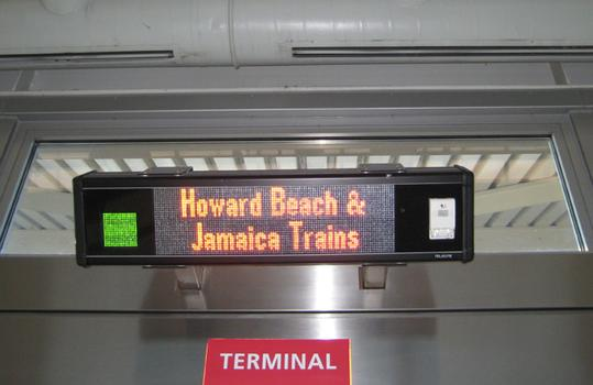 Inaccurate signs say a train goes to Jamaica and Howard Beach