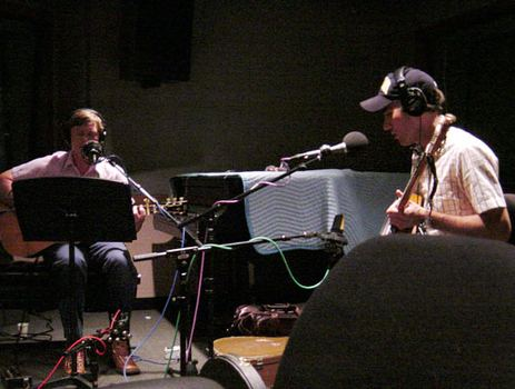 "Daniel and Sufjan perform ""Perennial Wine."" Note the bells wrapped  around Daniel's left ankle."