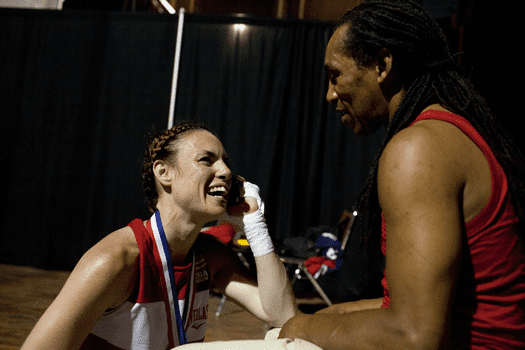 Heather Hardy with her coach, Devon Cormack, after winning the featherweight championship at Nationals.
