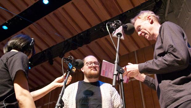 Dan Deacon and New Sounds Live host John Schaefer meeting and checking microphones before the performance from Merkin Concert Hall's Ecstatic Music Festival.