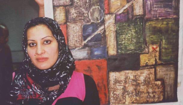 Iraqi Artist and Refugee Mariam Yahia with her work.