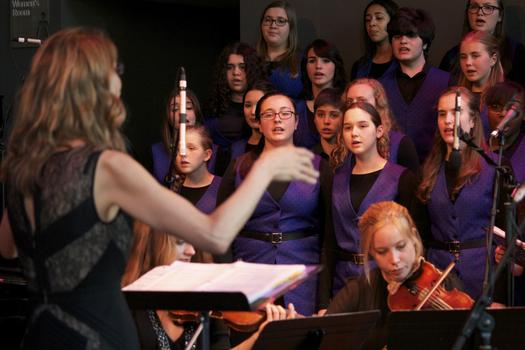Dianne Berkun, founder and artistic director, leads the Brooklyn Youth Chorus in the BAMcafé on the last day of the 2013 Crossing Brooklyn Ferry festival.