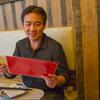 Concertmaster Frank Huang considers the menu at La Salle Dumpling Room