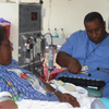 A Shands Hospital staff member plays music for a dialysis patient.