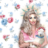 A graphic of Dolly Parton holding a lamb, both with crowns on their heads. They are against a floral background.