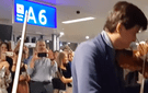 Members of the Camerata of Léman play for stranded passengers in a Swiss airport.