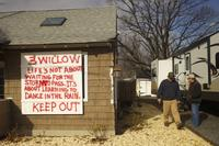 Barry Heffernan and Al Homan of Tri Bar Demoliton take a look at a Sandy-devastated home in Highlands, NJ. Heffernan has been contracted to raise the house up.  coastcheck