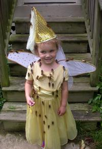 Girl in a princess costume covered in cicadas