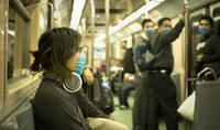 Mexico City train passengers wearing surgical masks