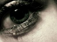 Close-up of a crying eye