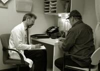Doctor and patient taking tests