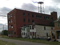 Detroit artists Blake Carroll and KT Andresky are planning to use old cigar factory (left) as an artist's workshop, with a ceramics studio, dance floor, retail and office space, and apartments.