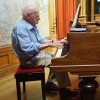 Re Vidler, age 87, playing the piano