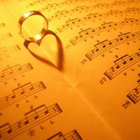 ring creates a heart on sheet music