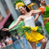 A performer does a traditional Polynesian dance at the NYDP 2010.