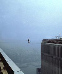 Philippe Petit walks between the two towers of the World Trade Center in 1974.