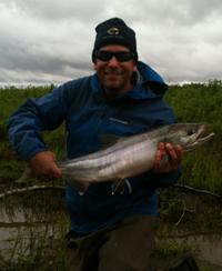 Paul Greenberg with his first catch of the season, a wild chum salmon