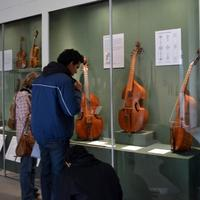 Visitors look at the Metropolitan Museum of Art's collection of viola da gambas