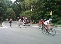 Bikers, runners and carriages in Central Park Saturday morning