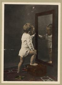 child looking into mirror
