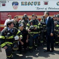 US President Barack Obama greets firefighters with the New York Fire Department at the Wall Street Heliport prior to boarding Marine One in New York, April 22, 2010. Obama traveled to speak about refo