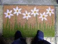 welcome mat with daisies