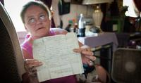 Clarice holds up her birth certificate