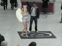 The Lynx angel appears in victoria station.
