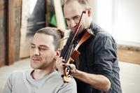 Hairy situation: Tadas Maksimovas transforms his hair into violin strings