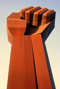 fist statue obelisk