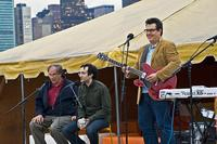 Radiolab hosts Jad Abumrad and Robert Krulwich with John Flansburg of They Might Be Giants