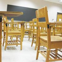 empty wooden desks in a classroom