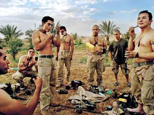Tikrit April 15, 2003 - US Marines take a break to shave in front of one of Saddam Hussein's presidential palaces the day Tikrit fell from Republican Guard rule.