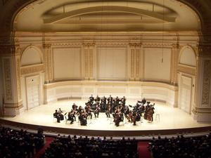Orpheus Chamber Orchestra opens the program with Schubert's Symphony No. 4 at Carnegie Hall.