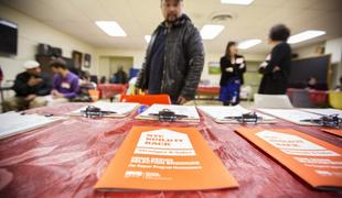 Cities and states hire private companies to help handle the workload after disasters, but homeowners still face long delays and other problems. Above, a table full of flyers at a community meeting for