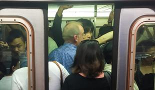 Subway doors close on crowded train at West 4th St.