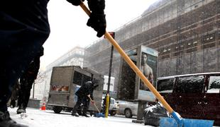 Shoveling snow on the second big snow fall of the year in Midtown, on January 21, 2014.
