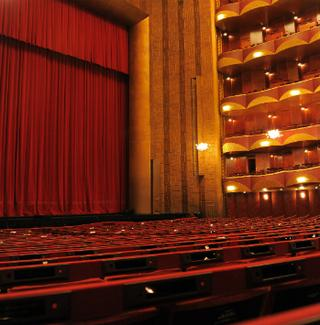 Projected title screens are attached to the seats at the Metropolitan Opera House