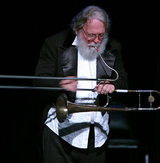 Peter Schickele plays a 'tromboon' in P.D.Q. Bach's 'Shepherd on the Rocks with a Twist' at Symphony Space in 2004